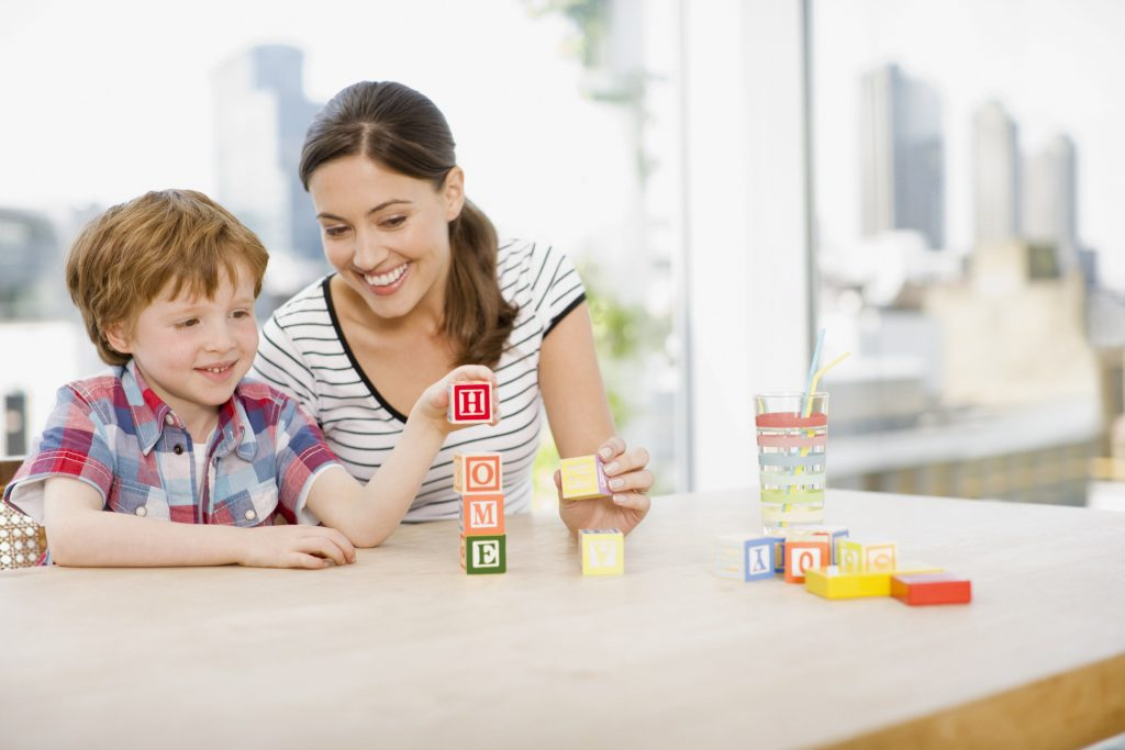 mom and child with blocks