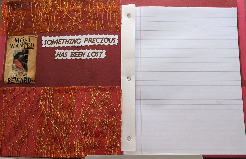 Picture of the inside of the journal with the paper inside.